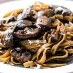 Spaghettini with mushrooms, garlic and oil